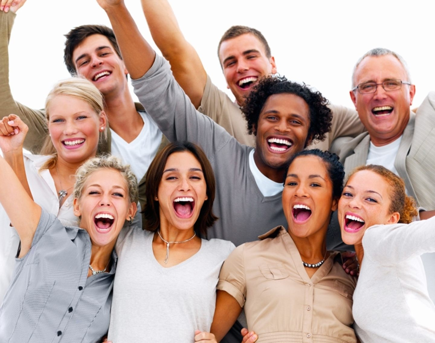 Portrait of a group of business people laughing against white ba